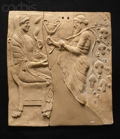 Terracotta Relief of Persephone (daughter of Zeus and Demeter; made queen of the underworld by Pluto in ancient Greek mythology) Seated on a Throne Receiving Dionysus.