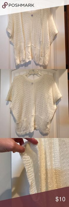 Crocheted wrap Cream colored crocheted wrap or shawl.  No buttons or anything. 100% acrylic material English Village Jackets & Coats Capes