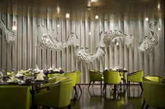 The main dining room is exemplary in taking traditional Chinese elements to another level in particular, with eye-catching carp-shaped cut-outs in elegant white curving beneath its spectacular golden ceiling.