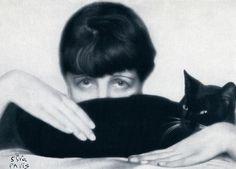 Madame D'Ora aka Dora Kalmus, Self-Portrait With Cat, c. 1925.