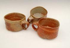 soup mugs, gas fired stoneware in sunset on the beach. via Etsy.
