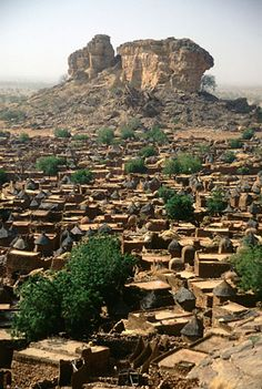 Africa | Sights and Sounds.  View of the Dogon village of Songha from the surrounding cliffs.  Mali.