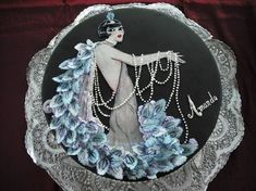 "By Cake Central member McLin  Completely hand-painted, with hand-piped ""pearls"" and 3D sculpted gumpaste ""feathers."""