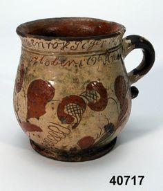 Mugg i lergods märkt 1796