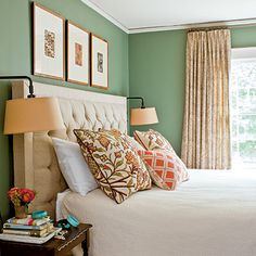 the perfect shade of green if your goal is to create a serene environment. The coral is such a complementary color and helps to give the room a cheerful feel