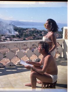 Portrait of Elizabeth Taylor with Richard Burton, 1963 Scheips believes this photograph of Taylor and Burton, taken during the time the pair were filming Night of the Iguana (Burton is holding a script), was taken by Francis or Sara Taylor. They are on the terrace of Casa Kimberley, which, a year after this picture was taken, Burton presented to Taylor for her 32nd birthday.