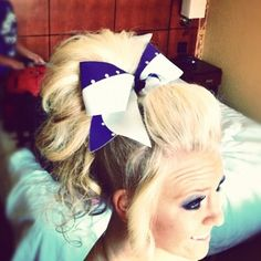 For cheer we could maybe try this?it will work for short(ish) hair and long hair! And i like her makeup!