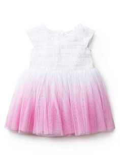 100% Nylon tulle dress. Features all-over ruffled tulle applique on upper body, with dip-dyed tulle skirts. Fully lined in 100% Cotton. Available in White as shown.