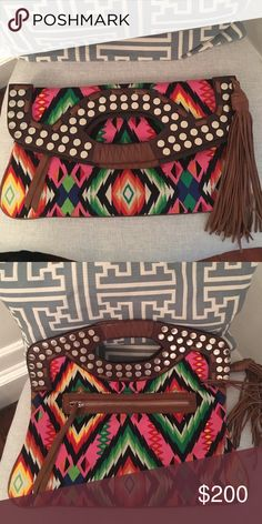 Oversize printed Cynthia Vincent Clutch Really cool tribal printed clutch with leather details and tassel. Cynthia Vincent Bags Clutches & Wristlets