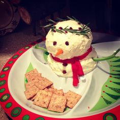 My snowman cheese ball.. Almost too cute to eat! My mother in law has a delicious cheese ball recipe: (double to make snowman, plus 16 oz whipped cream cheese!) 2 8oz cream cheese, 2 pkgs ranch dressing mix, handful of chives, 1/2 tsp garlic powder, 3 pkgs chopped dried beef. Mix all but 1 pk beef, refrigerate apx 4hrs til able to shape, form 2 balls for snowman body, roll in remaining chopped beef. I then built the body, covered with whipped cream cheese, garnish/decorate with edible…