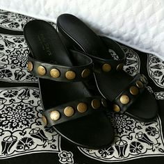 NWOT Black wedge sandles with brass brads Super cute black leather wedge sandles with brass brads across 2 top straps. Easy to walk in.  Bought in local botique, made in Italy.  Never worn except in house.  Perfect with everything.  Bought too small:( Cindy says Shoes Wedges