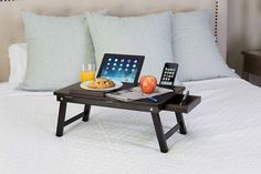 """Get it from Amazon for $39.86. Available in three finishes.Promising review: """"I love this tray. I actually just ordered a second one for myself. It folds down completely, so it is easy to store when it is not being used. It is the perfect size! It fits my laptop wonderfully, and it is so convent to have a mouse pad already built in so you do not have to worry about extra bulk. The little cutouts for your tablet and phone come in handy. I use this for my schoolwork and it is very handy to be…"""