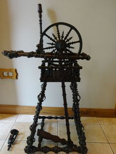 """Antique Primitive RARE Spinning Wheel Vintage HIGHLY ORNATE. Dimensions: Wheel diameter: 8.5"""" - 9"""" Height from floor to top of wheel: 32.75"""" Length of spinning wheel: 18"""" across 12.5"""" Depth of base legs"""