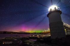 """Spaceweather.com Realtime Image Gallery Aurora at Marshall Point Lighthouse, Maine  The awe-inspiring green and purple colors of the Northern Lights spiked up early this morning while I was shooting the Milky Way down at Marshall Point Lighthouse in Port Clyde. This photo was taken about 5 feet from the base of the tower. I really like the shadow rays of light coming from the top of the lighthouse itself. The """"leaning tower"""" is caused by the barrel distortion via my wide angle lens – I…"""