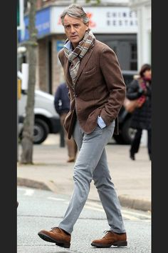 Roberto Mancini. Brown and grey is one of my favorite color combinations. Really like the grey chinos.  Jacket looks like Boglioli.