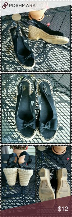 Black wedge sandles. Excellent condition,  only worn a couple of times. The upper part is a satiny material. The wedge is covered in rope. Adjustable ankle strap.  Approximately 3 inch heel.  Size 8.5 wide. Shoes Sandals