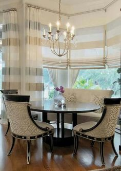 GAWD! These chairs. And check out how the stripes are aligned on the shades and drapes.