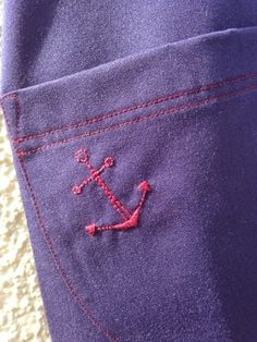 Embroidered anchor on dungaree dress Hannah Jane Fellows
