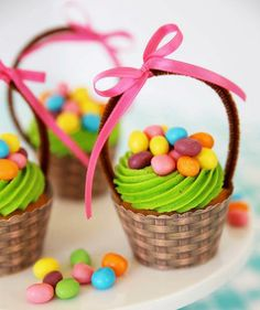 DIY Easter Basket Cupcakes: Cover the base of your cupcake in a printable basketweave wrapper, then pop a brown pipe cleaner (accessorized with a colorful bow, of course) into the cake.