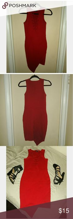 Front Lace up asymmetrical dress Front Lace up asymmetrical dress ... it has a bodycon type of material very stretchy and fitting super cute and trendy with a very pretty burgundy color perfect for fall!!! Will throw a bundle deal if you want the shoes they are a size 8! Hype Dresses Asymmetrical