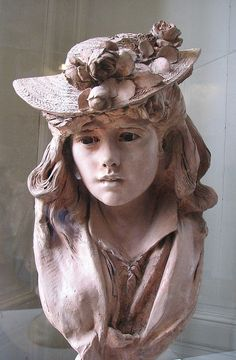 Rodin - Young Girl in a Flowered Hat. Sculpture of a young woman in the Rodin Museum, Paris. Terracotta, from about 1865.