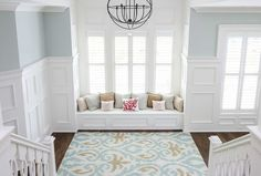 This a perfect area to chill and nook around at the top of stairs.  Also love the height of the wainscoting.