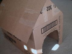 A cardboard doghouse makes the perfect accessory for a child who collects stuffed animals. An average cardboard box with top and bottom flaps has all ...