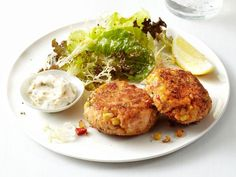 Salmon Cakes with Salad: Crab cake fans will love these less-expensive seafood cakes made with salmon and spiced with Old Bay.