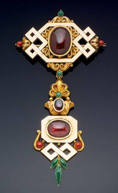 A gold, enamel, and garnet bodice brooch from 1830 that belonged to Queen Victoria,  features two large cabochon garnets in a setting of green and red enamel. The brooch originally belonged to Victoria, Duchess of Kent who on her death in 1861 left her jewelry to her daughter, Queen Victoria.