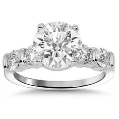 This exquisite diamond engagement ring is crafted in lustrous Platinum. The center is prong set with one CLARITY ENHANCED round cut diamond which weighs 2.01 carats and is F/G in color and VS2/SI1 in clarity. The four round cut side stones are G in color and VS2 in clarity and total to 0.63 carats. The frame measures to 8 mm in width and weighs 6.2 grams. $11,210.00