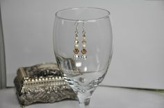Brown and Creme Swarovski Crystal Drop Earrings Handmade Design $15.00 These elegant earrings are great for weddings and other special occasions designed to make you feel luxurious and beautiful on your special day. Thanks for stopping by The Secret Jewelry Box.