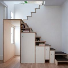 Plywood+staircase+by+Buj+Colón+Arquitectos++integrates+shelves+and+cupboards+for+a+small+flat