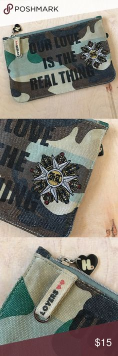 Harajuku Lovers Camo Pouch Super cute pouch that can be used as a pencil pouch or make up bag or whatever you want! 9 1/2 inches long, 6 inches tall. Harajuku Lovers Bags Mini Bags