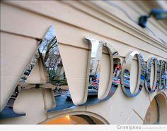 6a511a2b45 Enseigne boutique Huile Olive – Oliviers & Co réalisée en inox brossé. Nous  avons fabriqué et installé l'enseigne Oliviers & C… | façade et enseigne