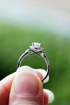 Engagement ring with infinty sign incorporated in the band