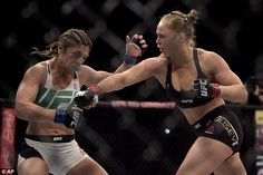 She's a knockout! Ronda Rousey hits back at body-shamers who called her 'masculine' by proudly wearing a crop top and shorts while celebrating her UFC title victory