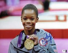 Gabby Douglas Autographed 11X14 Photo Olympics Holding Gold Medal GV801963