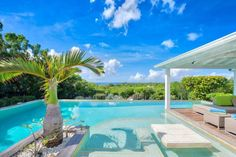 Located in the deed community of Terres Basses (Low Lands), Kiwi is a spacious and elegant three-bedroom villa overlooking the Caribbean Sea. This new villa, tastefully designed and decorated by our architects, ...