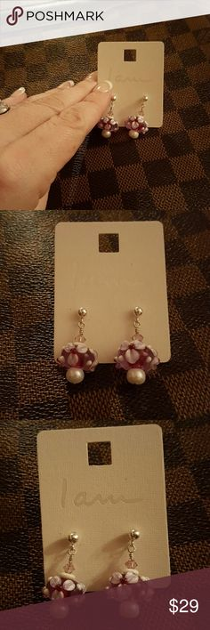 Handmade earrings Placed them on display holder for pics only. A friend of mine handmade these. Very beautiful. Jewelry