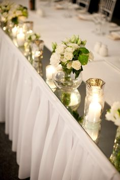 back wall side of jerry table - square mirror tiles w/candles. could use real or color battery ones. Bridal Table Decorations, Bridal Party Tables, Head Table Decor, Deco Table, Wedding Centerpieces, Head Tables, Centrepieces, Wedding Reception Flowers, Floral Wedding