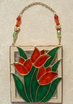 Red Orange Tulips Flower Ornament Stained Glass Wall Hanging and Suncatcher. Handmade Stained Glass Flower Artwork. Stained glass art hand painted on textured art glass for home, kitchen and bathroom flower theme decor. Decorative creative artwork made by Pat Desmarais in the USA , $30.00