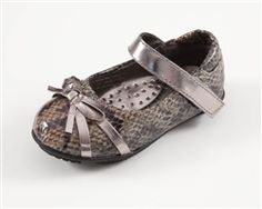The Prima Arena toddler shoe is a stylish neutral-tone snake Mary Jane designed to coordinate with Mom's favorite everyday pair.  The pewter strap features a  velcro closure for a secure fit while providing easy on and off access. The cushioned insole with arch support offers comfort and the skid resistant rubber outsole provides stability.