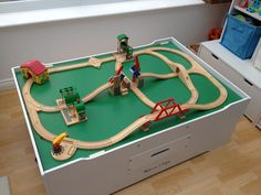 A Brio viaduct and suspension bridge, along with a lifting bridge makes this wooden train track a real up and down ride for the wagons, freight and passengers. Wooden Toy Train, Wooden Toys, Thomas The Train Tracks, Trains Birthday Party, Train Table, Suspension Bridge, Brio, Train Layouts, Train Set