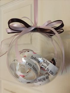 Memento ornament from my grand daughters baby shower. Inside is an invitation cut into strips and curled. The ribbons are coordinating colors from the invitation.  March 2016