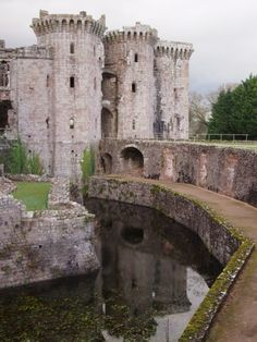 The three-storey gatehouse to Raglan Castle (Raglan, Wales) dates from the 1460s and is approached over a stone bridge restored in 1949. Characterised by extensive machicolations and gunloops, the gatehouse would originally have had a twin-set of portcullises and a drawbridge. The intention of the design was at least partially defensive, but was also intended to provide a dramatic and impressive entrance for senior visitors to the castle.