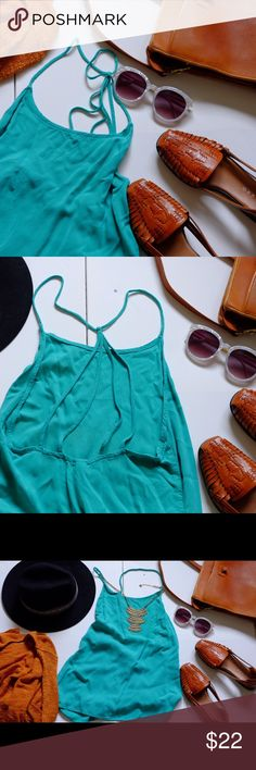 Strappy back teal / turquoise tank Perfect for the beach or just a hot summer day! ☀️☀️☀️ cute strappy back, gorgeous real/turquoise color, soft fabric. NOT URBAN OUTFITTERS - tagged for exposure Urban Outfitters Tops Tank Tops