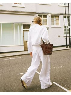 Alternative to jeans: Lucy Williams wears crisp white linen trousers teamed with a white denim jacket and brown basket bag