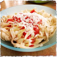 Fettuccine tomatoes and asiago cheese.