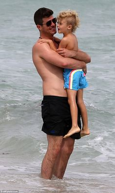 Bonding: Robin Thicke was spotted enjoying some quality time with his son Julian on the beach in Miami on Sunday