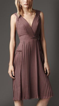 Elegant georgette wrap dress with distinctive traversing pleats